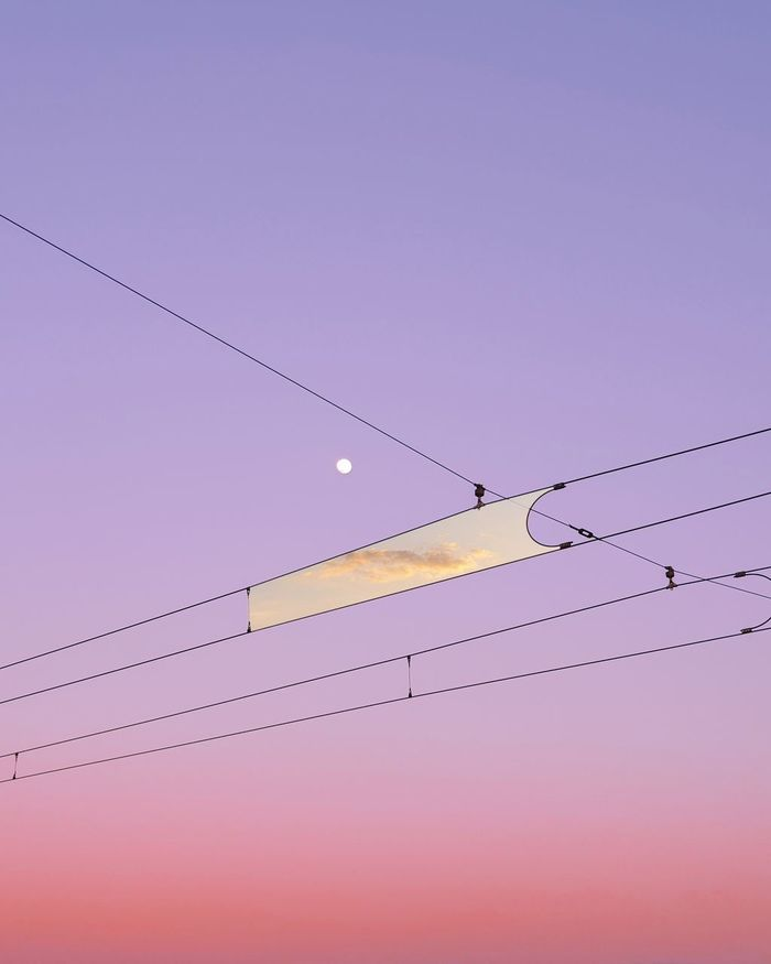 Digital composite image of clouds amidst cables against sky during sunset