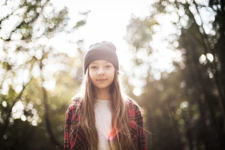 Portrait of girl standing in forest
