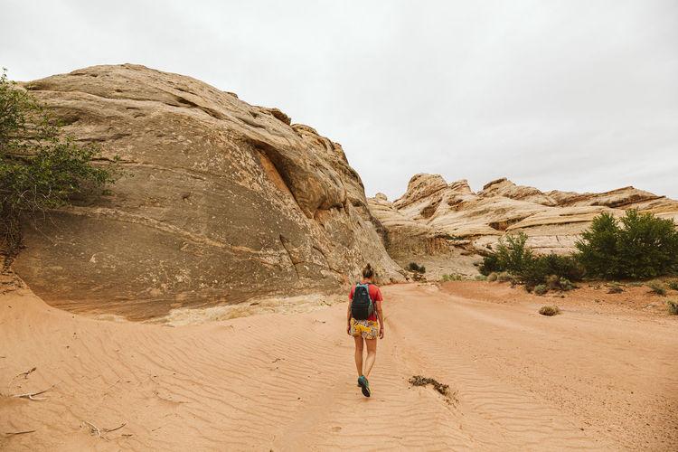 Rear view of women walking on rocks