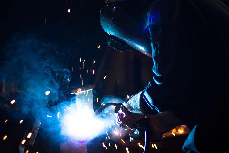 Welder welding in workshop