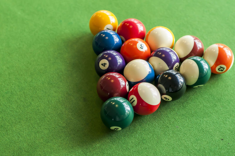 High angle view of multi colored balls on table