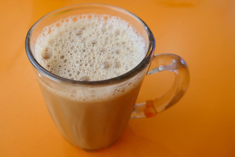 Orange Color Horizontal Singapore Traditional Drink Hot Drink Bliss Indulgence Pull Tea Pulled Tea Teh Tarik Tea Milk Tea EyeEm Selects Drink Refreshment Food And Drink Mug Indoors  Cup Glass Colored Background Household Equipment Still Life Drinking Glass Frothy Drink Close-up Freshness