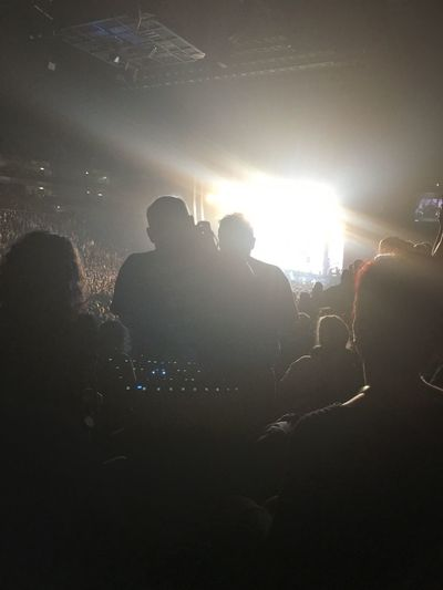 Silhouette of people at music concert