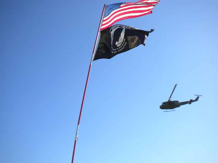 Helicopter POW MIA Blue Clear Sky Day Flag Flag Pole Flying Freedom Independence Low Angle View No People Outdoors Patriotism Pow Mia Flag Pride Sky Stars And Stripes Wind