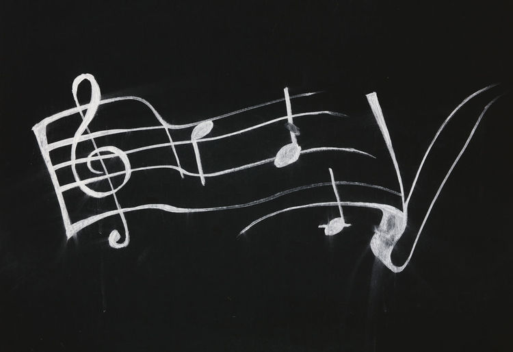 White notes over black background Music Paint Text Writing Black And White Black Background Chiave Di Violino Close-up Music Is Life Music Is My Life Notes Outdoors Song