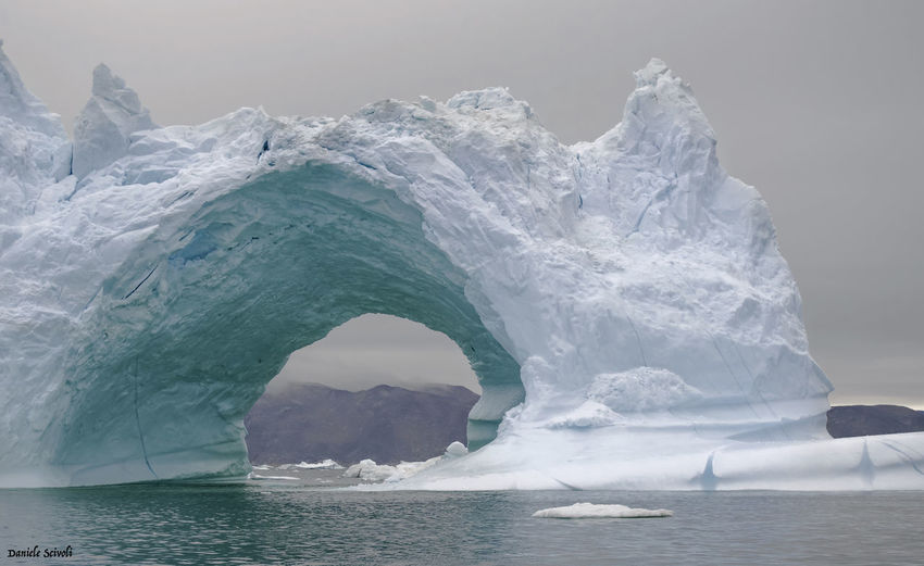 Another picture of the iceberg Amazing Arctic Beautiful Beauty In Nature BIG Cold Day Glacier Greenland Hole Iceberg Icebergs Ilulissat Mountain Nature Nature Nikon Nikonphotography Ocean Picture Sailing Sea Sky Tunnel Water