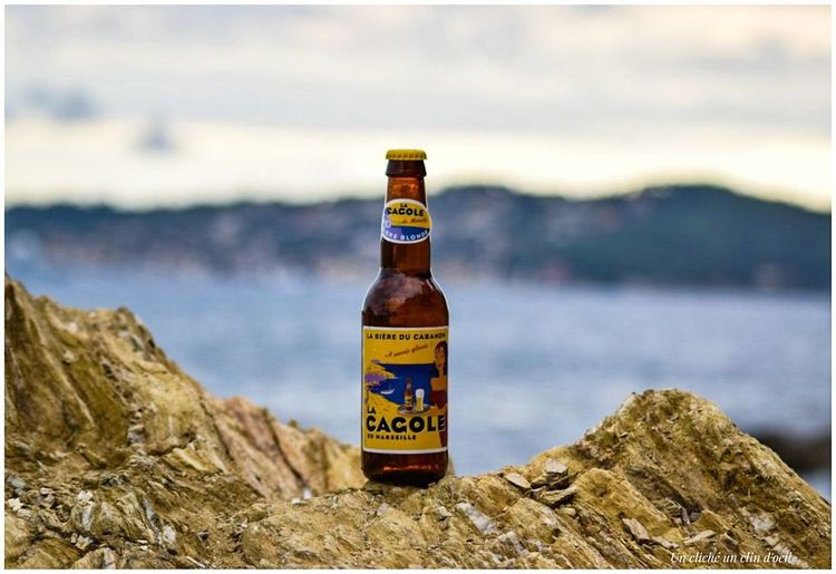 Une petite bière au bord de l'eau😍 Bottle Beach Close-up Focus On Foreground No People Water Day Sea Outdoors Fragility Nature Sky Freshness Bier Time Bière Lacagole Marseille Second Acts EyeEmNewHere Unclicheunclindoeil