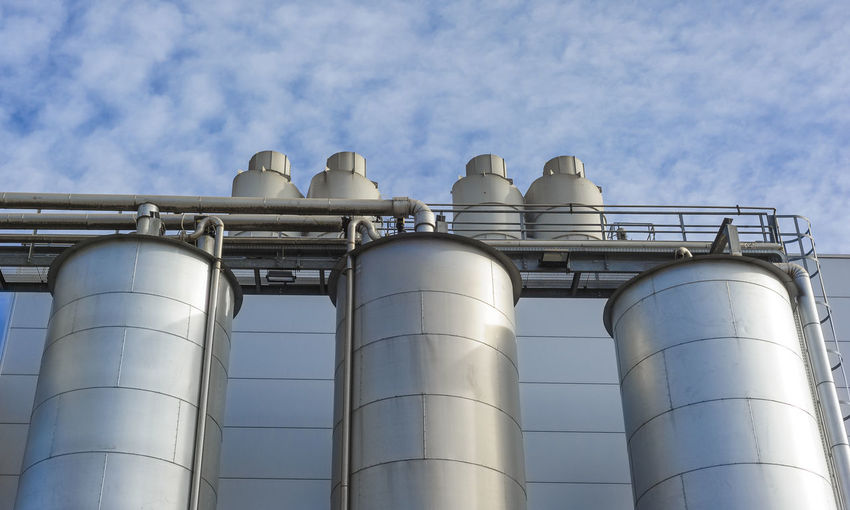 Low Angle View Of Industry Against Sky