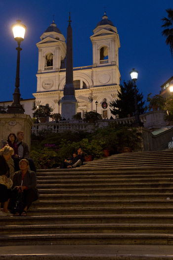 Stairs at Rome Architecture Blue Building Exterior Built Structure Church Exterior Façade Historic Illuminated Low Angle View No People Orange And Blue Outdoors Piazza Di Spagna Place Of Worship Religion Sky Spirituality Stairs Street Lights Temple - Building Towers Travel Destinations Church Tower Church Towers