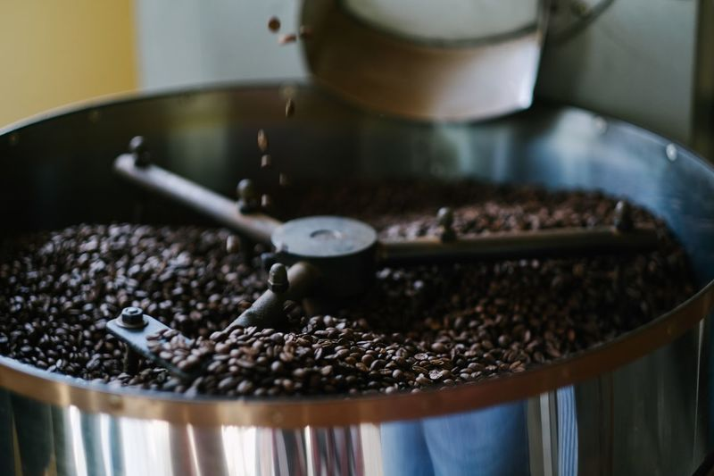 Coffee being roasted Coffee Coffee Bean Coffee Beans Coffee ☕ Food And Drink Food Coffee Coffee - Drink Preparation  Close-up Indoors  Freshness No People Selective Focus Roasted Coffee Bean Abundance Container Still Life Roasted Drink Machinery Kitchen Utensil Brown