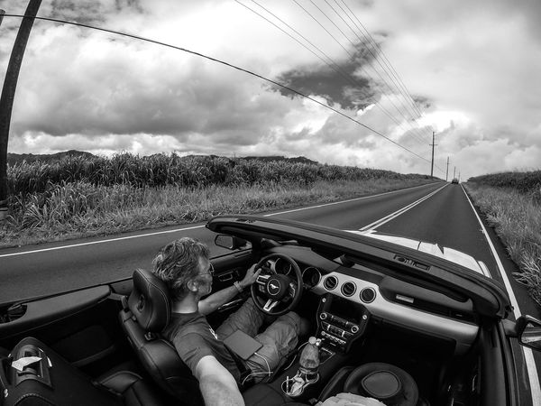 Driving the north shore of Oahu Black And White Car Car Interior Convertible Cruisin Day Ford Ford Mustang Having Fun Hawaii Land Vehicle Mustang Oahu On The Road Open Top Outdoors Rain Real People Self Portrait Sports Car The Drive Transportation USA Vehicle Interior Long Goodbye Second Acts