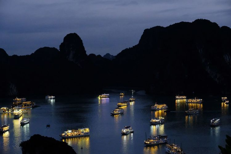 Vietnam, Halong Bay Reflection night water no people nautical vessel outdoors Reflection Night Water No People Nautical Vessel Outdoors Vietnam Halong Bay Illuminated Sea Travel Destinations Scenics Mountain Architecture City Sky Astrology Sign The Traveler - 2018 EyeEm Awards HUAWEI Photo Award: After Dark