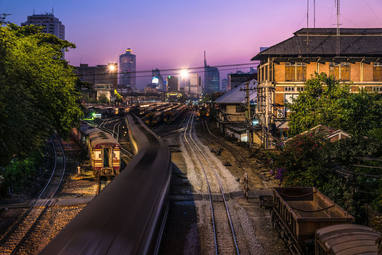 Twilight and Bangkok Railway at Hua Lamphong Station in Thailand. It is the main railway station in Bangkok, Thailand. Architecture ASIA Building Building Exterior Built Structure Central City City Life Cityscape Growth Hua Lamphong Railway Station, Bangkok, Thailand Illuminated Modern No People Outdoors Residential Building Residential District Residential Structure Sky Thailand The Way Forward Train Transportation Tree Twilight