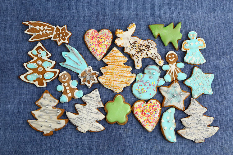 Christmas Cookies Gingerbread Homemade Food Decoration Colorful Colors Sweets Sweet Handmade Blue Background Textured  Cookie Baked Shape Variation Celebration Representation Sweet Food Directly Above Indoors  Still Life Creativity Choice Large Group Of Objects Design Star Shape Food And Drink No People Holiday Gingerbread Cookie Icing Temptation Star Tree Reindeer