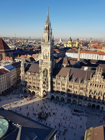 altes Rathaus und Marienplatz Backgrounds Copy Space Fotoexpeditionen Rwfart EyeEm Selects EyeEmNewHere Blue Sky München Germany Bayern Clear Sky Marienplatz Aerial View cityscapes City Life Cityscape Snow Cold Temperature City Sky Architecture Clock Tower