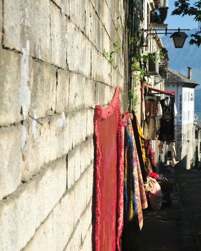 Clothes drying on wall by building