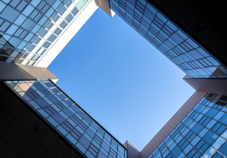 Krull&Krull Architecture Glass Directly Below Skyscraper Sunlight Window Day Tall - High Nature Blue No People Office Glass - Material Modern City Building Building Exterior Built Structure Low Angle View Sky Architecture Geometric Shape Office Building Exterior Office Building Clear Sky Copy Space Futuristic Downtown District Business Finance And Industry Business Financial District  Krull&krull Backyards