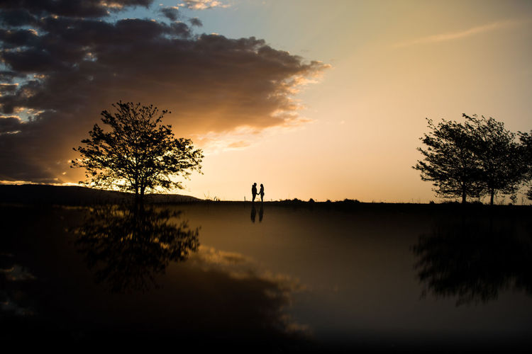 Beauty In Nature Cloud - Sky Day Growth Lake Men Nature One Person Outdoors People Real People Reflection Scenics Silhouette Sky Sunset Tranquil Scene Tranquility Tree Water