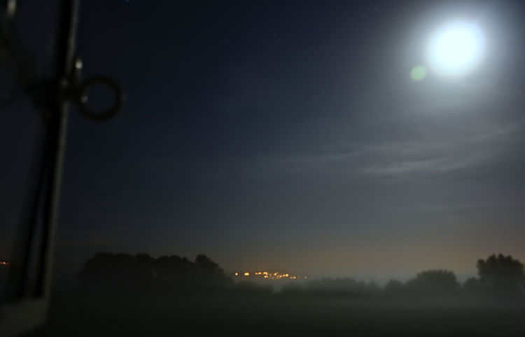 Moon at Glastonbury Atmosphere Blue Bright Night Cloud - Sky Cloudy Dark Dusk England Fog Glastonbury Glowing Green Landscape Moon Night No Animals No People Out Of The Window Outside Sky Town Uk White Window Wood