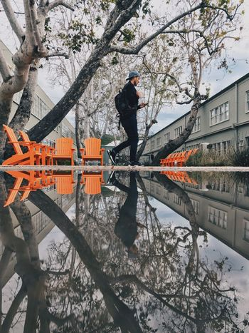 Mobile Conversations Reflection Men Architecture Real People Working One Person Worker VSCO Streetphotography Losangeles EyeEm City Lifestyles EyeEm Gallery Architecture Shotoniphone7plus IPhoneography Mobilephotography Vscox Silicon Beach Playa Vista Runway