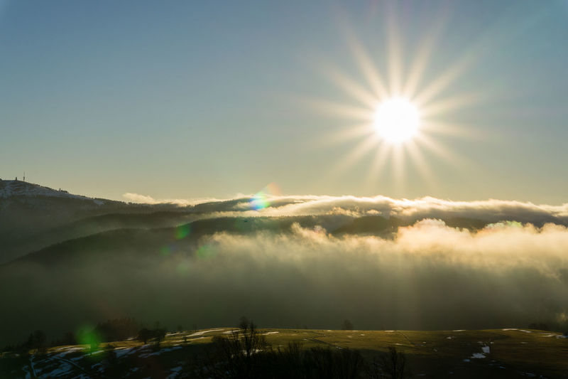 Sonnenaufgang auf dem Schauinsland Beauty In Nature Day Idyllic Landscape Lens Flare Mountain Nature No People Outdoors Scenics Sky Sun Sunbeam Sunlight Sunset Tranquil Scene Tranquility