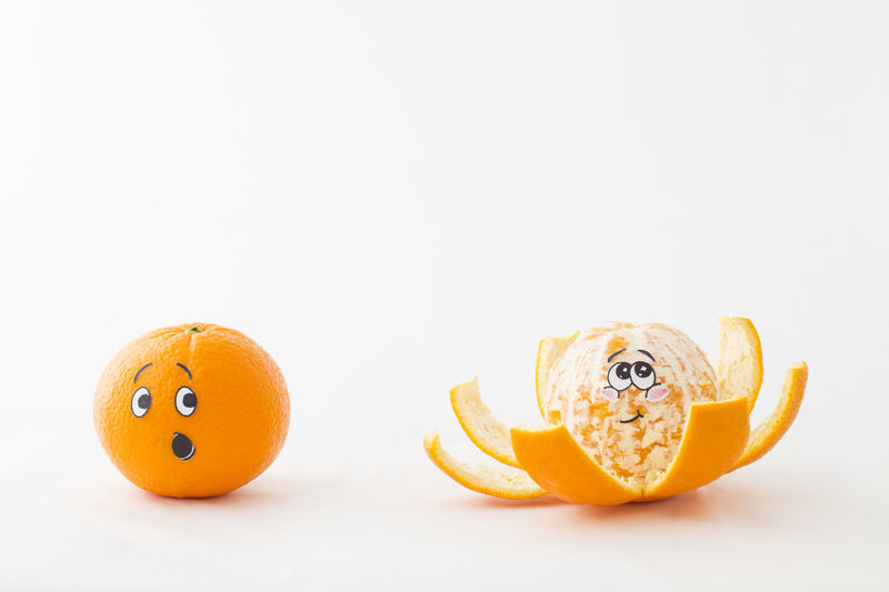 One tangerine with an astonished face and a peeled tangerine with blushing face in front of white background Astonished Blush Fun Funny Anthropomorphic Face Cartoon Citrus Fruit Close-up Cute Food Food And Drink Freshness Fruit Fruits Funny Faces Healthy Eating Juicy No People Orange Color Studio Shot Surprise Tangerine Vitamin White Background Yellow
