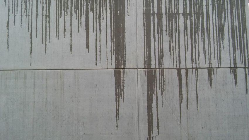 Rain dripping down a Concrete Wall