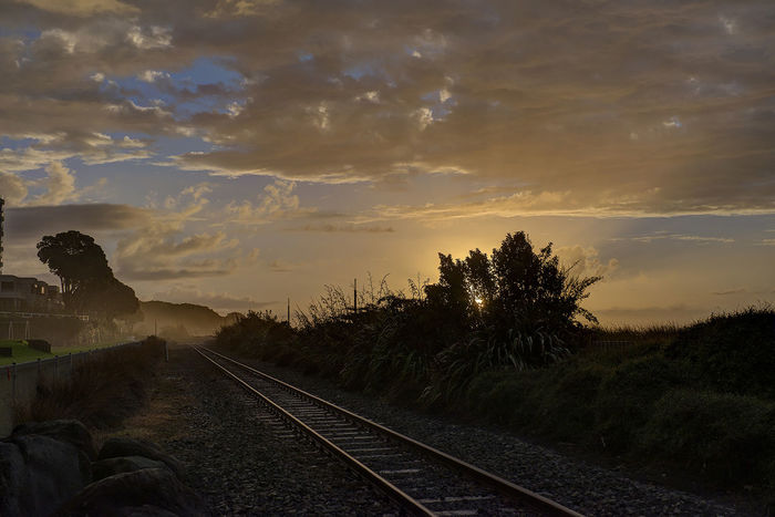 A long way from home.. home sweet home..taken at New Plymouth Railway Sunset by the Beach