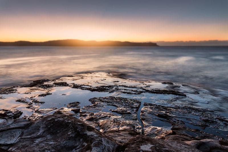 sunrise over Pearl Beach, NSW, Australia Sunrise Coastal Feature Low Tide Coast Romantic Sky Dramatic Landscape Seascape Headland Coastline Tide