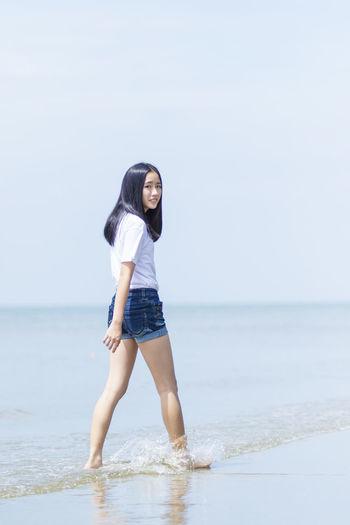 Full length of girl walking at beach
