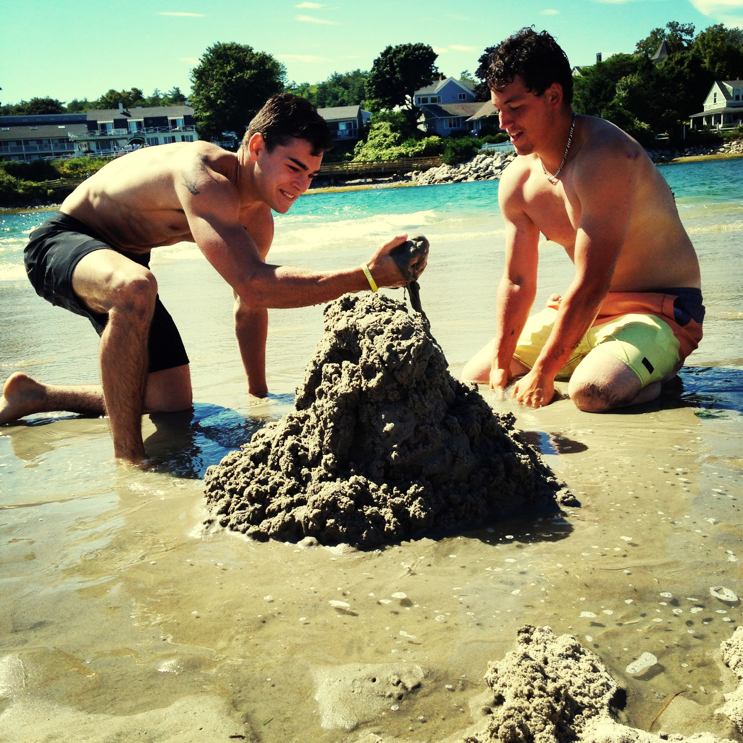 water, beach, lifestyles, leisure activity, person, togetherness, sea, vacations, sand, bonding, childhood, enjoyment, boys, shore, shirtless, young men, elementary age