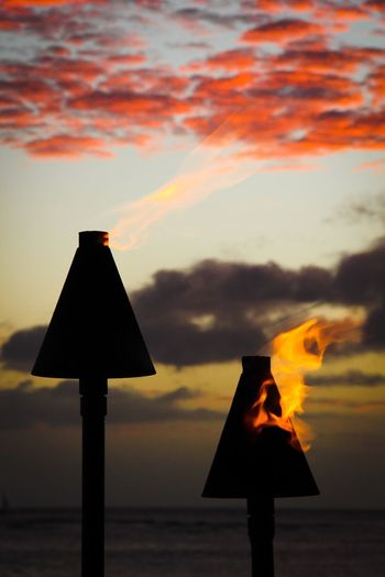 Sunset Water Tranquil Scene Scenics Tranquility Sea Dusk Safety Cloud - Sky Guidance Information Sign Sky Beauty In Nature Vibrant Color Dramatic Sky Pole Cloud Moody Sky Focus On Foreground Outdoors Lantern Torch Torchlight Torches Sunsets