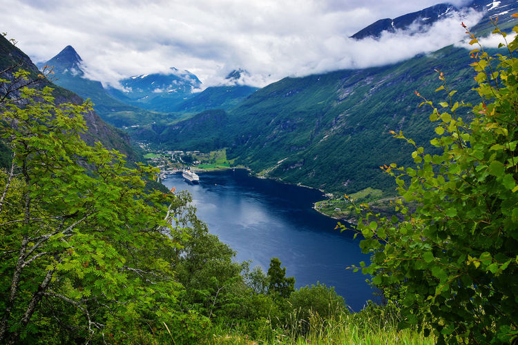 Scenic view of river amidst mountains against sky