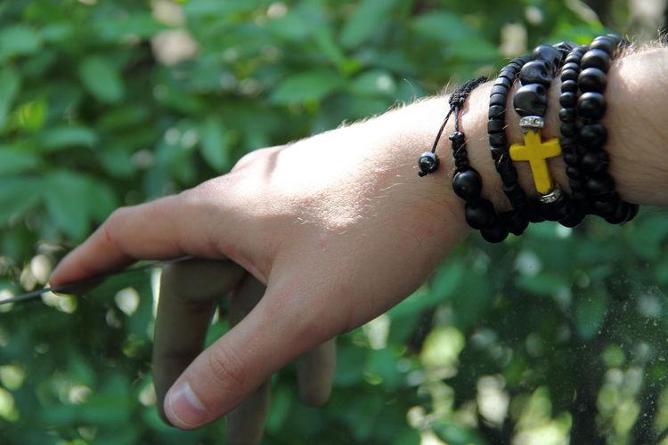Cropped hand of man wearing bracelets