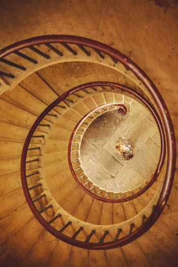 Directly Above Shot Of Woman Seen Through Spiral Staircase