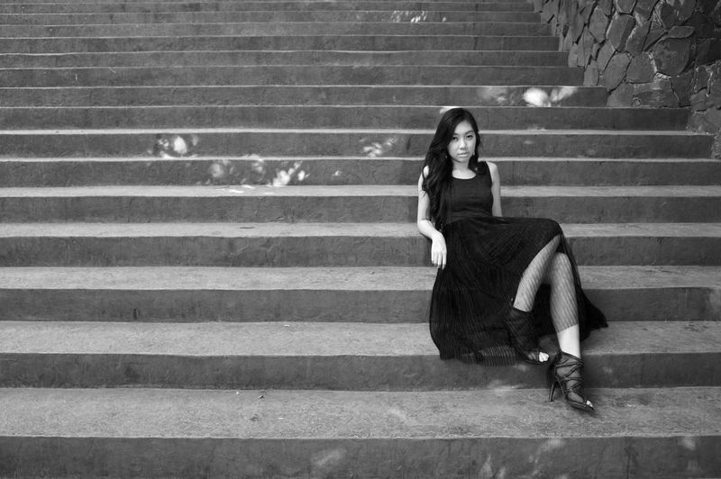 Woman Young Adult Young Woman Sitting Portrait Stairs Steps Rule Of Thirds Serious Look Outdoors Black And White Long Hair High Heels