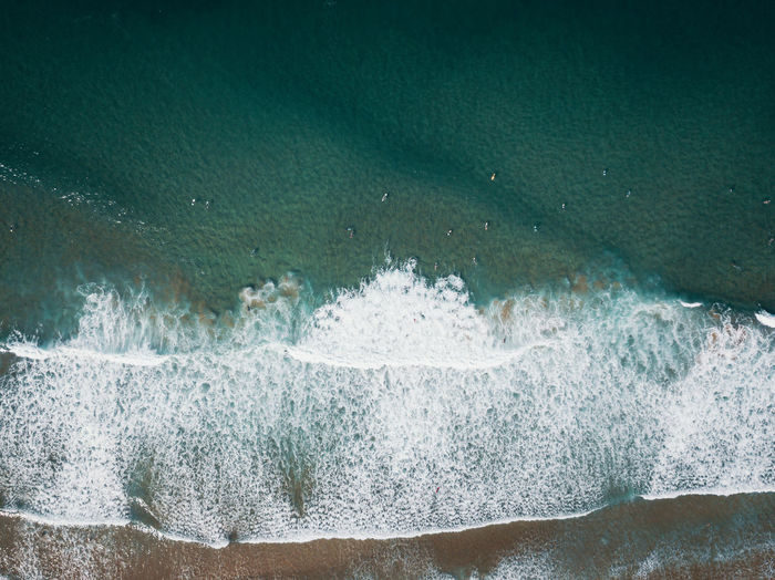 High angle view of wave splashing on beach