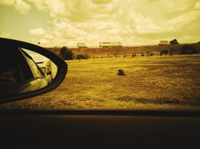 Reflection on field seen through car windshield