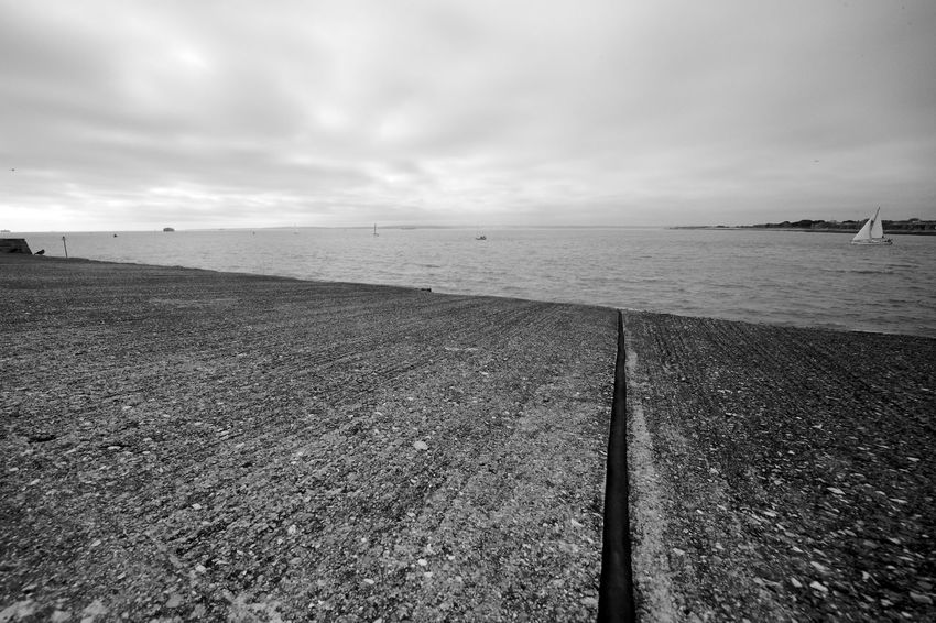 Leaving Harbour Black & White Sea Wall Blackandwhite Horizon Over Water Nature No People Outdoors Sailing Sea Sea Defence Sky Water