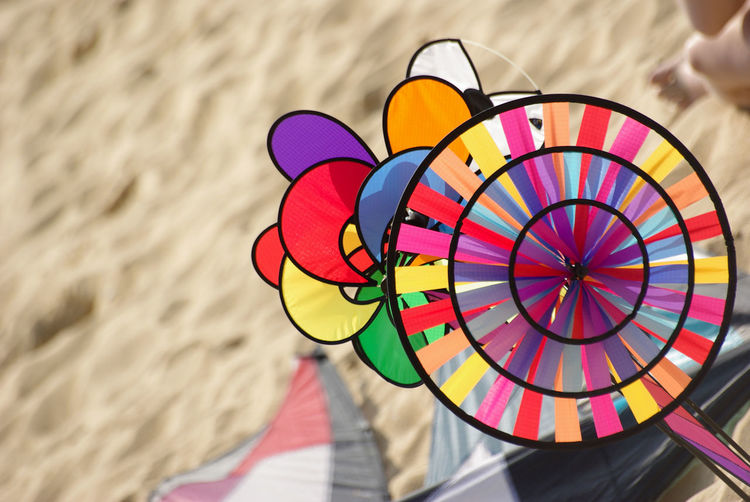 High angle view of colorful pinwheel toy at beach