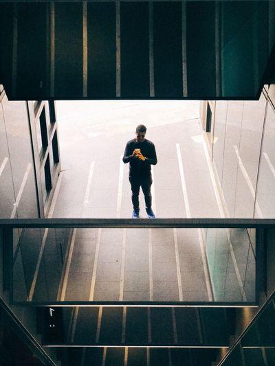 Rear view of boy walking in city