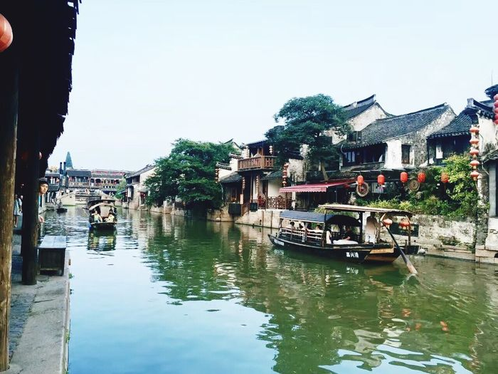 Xitang Building Exterior Architecture Water Built Structure Nautical Vessel Transportation Outdoors Mode Of Transport Tree Reflection Waterfront River Clear Sky No People Sky