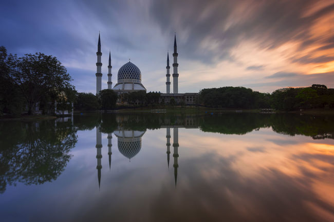 Reflection of a modern beautiful mosque at sunrise on motion long exposure in Shah Alam, Malaysia. Allah Architecture Building Exterior Built Structure Cloud - Sky Day Dome Moscow No People Outdoors Place Of Worship Ramadhan Ramadhan Kareem  Reflection Religion Shah Shah Alam Sky Spirituality Sunrise Travel Destinations Tree Water Waterfront HUAWEI Photo Award: After Dark