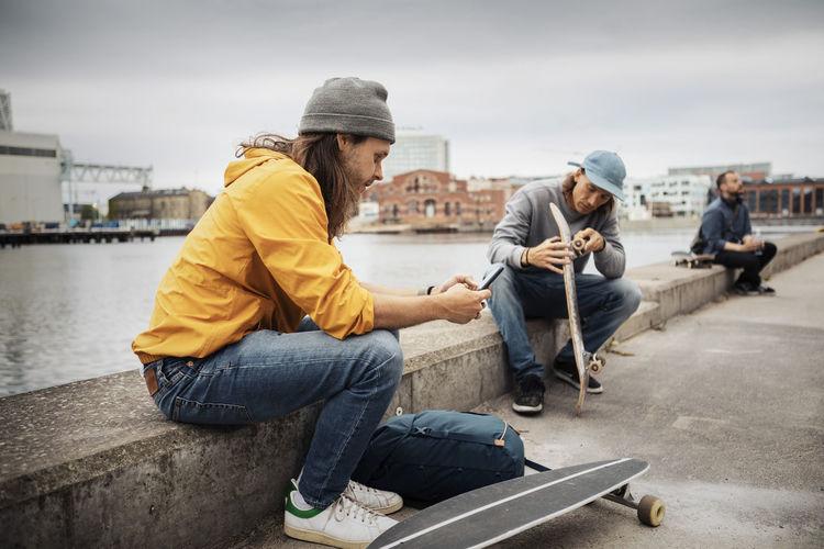 Men sitting in city