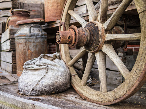 Historical things. Can Close-up Day Detail Historical Milk Can No People Outdoors Wheel Wood - Material