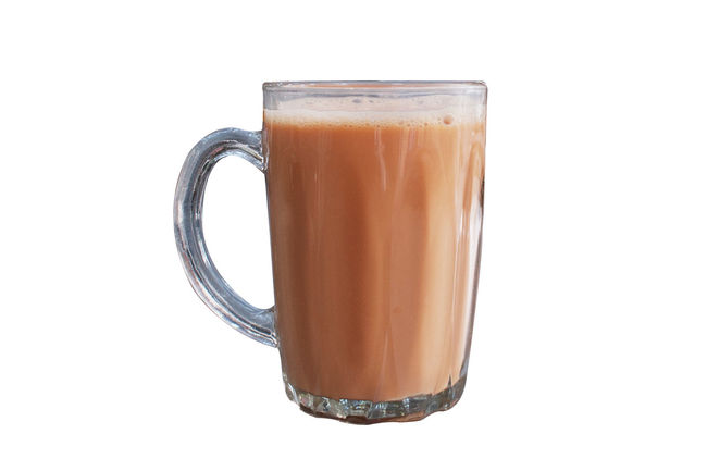Hot milk tea known as Teh Tarik in a mug isolated over white background view from side. Advertising Beverage Food And Drink Holiday Isolated Teh Tarik Teh Tarik (Malaysian Pull Tea) Travel Bussiness Cropped Cultures Healthy Eating Healthy Lifestyle Indian Food Malaysia Milk Tea People Prata Roti Canai Travel Destinations White Background