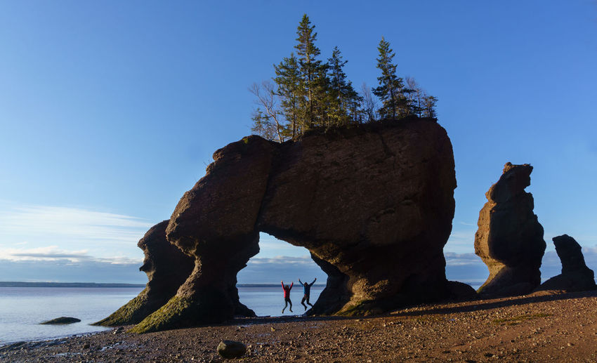 Hopewell Jump America Bay Of Fundy Beach Blue Canada Clear Sky Colorful Freedom Friendship Hopewell Rocks Hopewell Rocks Park Jump Landscape Love Low Tide Morning Light Nature New Brunswick, Canada Rock - Object Scenics Sunrise Tranquil Scene Tranquility Travel Destination Water