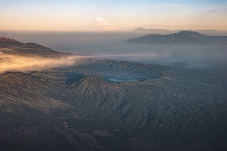 Aerial view of volcanic mountain against sky during sunset