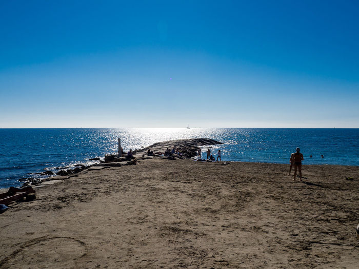 Sea Horizon Over Water Sky Beach Water Clear Sky Nature Outdoors Real People Scenics Vacations Tranquility Beauty In Nature One Person Day Sand People Adult Adults Only Zörk