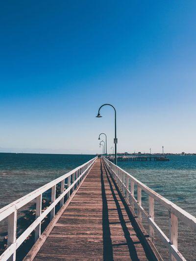 Beautiful wooden pier on an australian beach against clear sky